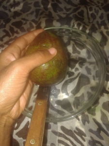Freshly washed ripe avocado pear.